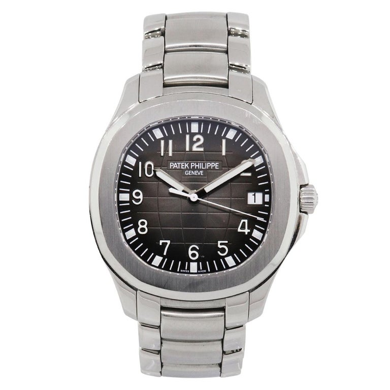 Brand: Patek Philippe MPN: 5167A Model: Aquanaut Case Material: Stainless Steel Crystal: Scratch resistant sapphire Bezel: Brushed stainless steel bezel Dial: Grey embossed dial with date displayed at 3 o' clock. Bracelet: Stainless steel Size: Will