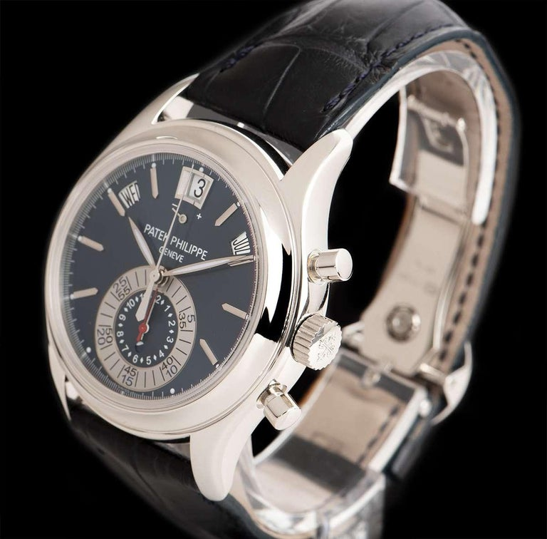 A Platinum Annual Calendar Gents Wristwatch, blue dial with applied hour markers, month aperture between 1 and 2 0'clock, 60 minute and 12 hour mono counter at 6 0'clock, day aperture between 10 and 11 0'clock, date aperture and power reserve