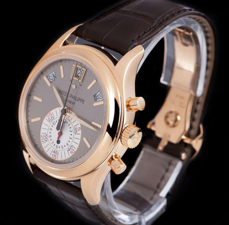 An 18k Rose Gold Annual Calendar Gents Wristwatch, grey dial with applied hour markers, month aperture between 1 and 2 0'clock, 60 minute and 12 hour mono counter at 6 0'clock, day aperture between 10 and 11 0'clock, date aperture and power reserve