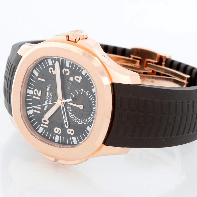 Patek Philippe Aquanaut Travel Time 18K Rose Gold Mens 5164R (5164 R ) - Self-winding / Automatic winding. 18K Rose gold with exposition back ( 40 mm ). Brown waffle dial with gold applied numerals with luminescent coating. Dark brown polymer