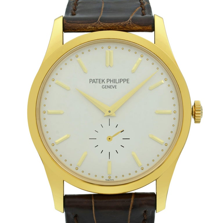 Open date Papers. This watch is in good preowned condition with minor signs of wear on a leather strap. Comes with manufacturers' papers and a Patek travel box. Covered by a one-year Chronostore warranty.  Details: Brand Patek Philippe Color