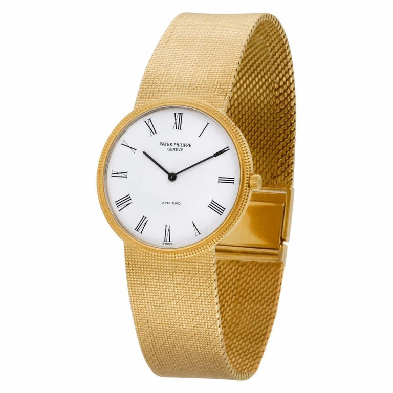 Patek Philippe Calatrava Reference #:3520DJ-001. Patek Philippe Hobnail Bezel Calatrava in 18k yellow gold on a 18k yellow gold mesh bracelet signed DA (DE AGUSTINO ), Manual movement.. Comes with Archive papers. 32 mm case size. Ref 3520. 7.75