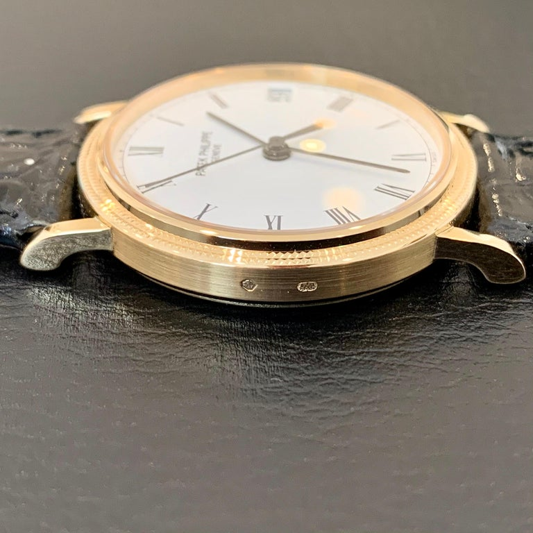 Elegant 18K Gold watch by Patek Philippe. Calatrava 3802. Original papers included. Mens. Automatice. Self-wind. Original band, stamped Patek Philippe on backside of leather. Near mint condition as shown in photos. Originally purchased circa 2002.