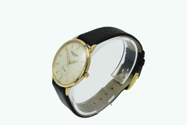 Style Number: 3893J     Model: Calatrava      Case Material: 18K Yellow Gold     Band: Custom Black Leather Band     Bezel:  18K Yellow Gold     Dial: Ivory     Face: Sapphire Crystal     Case Size: 33mm     Includes:   -Elegant Watch