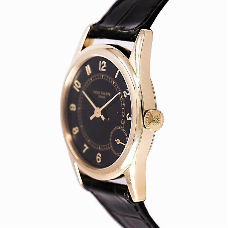 Contemporary Patek Philippe Calatrava 5000J, Black Dial, Certified and Warranty For Sale
