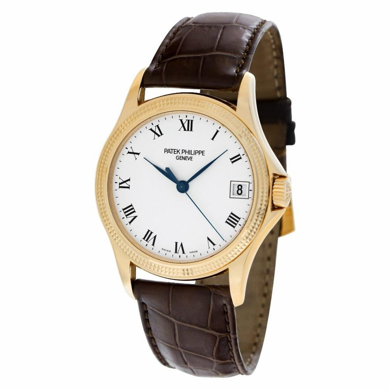 Patek Philippe Calatrava in 18k rose gold on brown alligator strap with 18k rose gold tang buckle. Auto w/ sweep seconds and date. 37 mm case size. With papers. Ref 5117R-001. Circa 2002. Fine Pre-owned Patek Philippe Watch. Certified preowned Dress