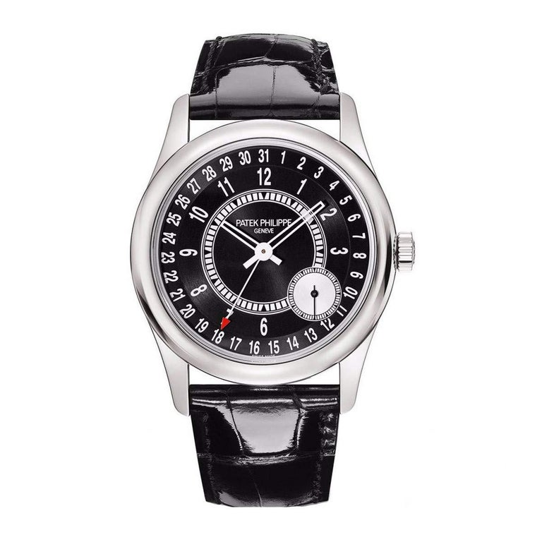 This brand new Patek Philippe Calatrava 6006G-001 is a beautiful men's timepiece that is powered by an automatic movement which is cased in a white gold case. It has a round shape face, date, small seconds subdial dial and has hand arabic numerals