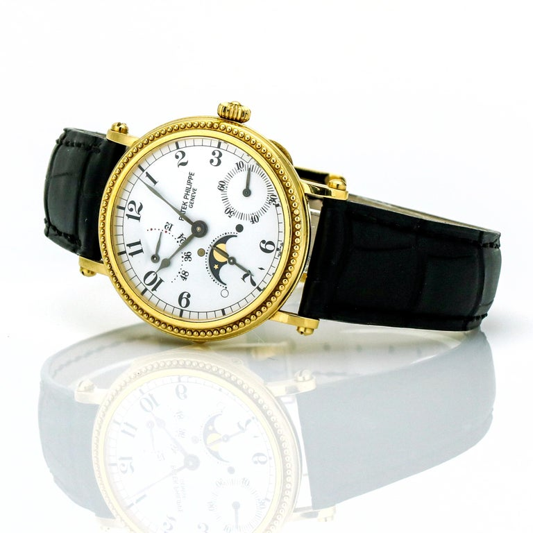 Patek Philippe Calatrava 5015. Polished 18-karat yellow gold case with decorated bezel, monobloc case back with sapphire glass, protected by cover with hinge. Sapphire crystal. White Arabic numeral dial with black oxidized Stuart hands. Power