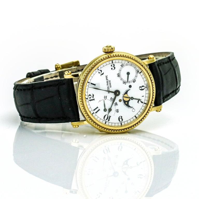 Patek Philippe Calatrava Power Reserve Moon Phase 5015J 18Kt Gold Men's Watch In Excellent Condition For Sale In Fort Lauderdale, FL