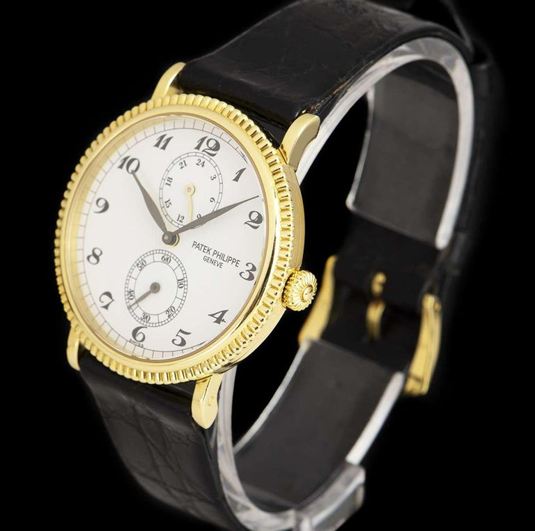 Patek Philippe Calatrava Travel Time 18k Yellow Gold White Dial B&P In Excellent Condition In London, GB