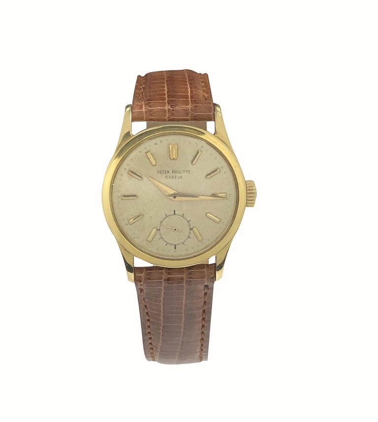 Circa 1950s Patek Philippe Calatrava Reference 2545, 32 M.M. 18K yellow Gold 2 piece case with Water Proof Back, 18 Jewel, Caliber  12-400 Mechanical, Manual wind nickle Lever movement, Patek Philippe Logo Crown.  Silver Satin Dial with Raised Gold