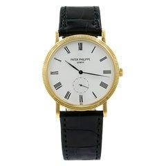 Patek Philippe Calatrava Yellow Gold White Roman Dial Hand Wind Watch 5119J-001