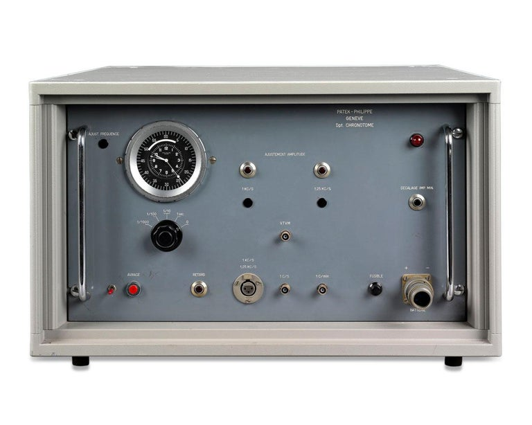 This rare, one-of-a-kind quartz-controlled electronic chronotome clock was crafted by the renowned Patek Philippe of Geneva as part of the firm's Electronic Clock System. Every Patek Philippe electronic clock was made on a special commissioned