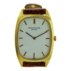 Patek Philippe & Cie 18 Karat Yellow Gold Tonneau Shaped Wrist Watch, circa 1975