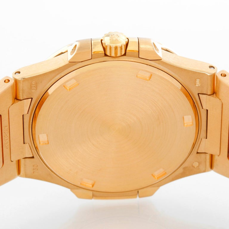 Patek Philippe & Co. 18 Karat Rose Gold Nautilus Diamond Watch 7010R In Excellent Condition For Sale In Dallas, TX