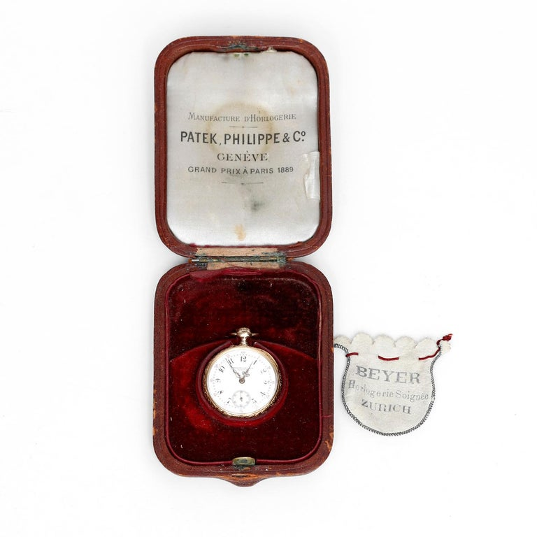 Patek Philippe & Co. Lady's Pocket Watch - Manual movement; 15 jewels. 18k Yellow gold ( 32 mm ) with gold cuvette, swirl leaf and scallops, back with ornate overlay monogram. Enamel dial with radial arabic numerals and red five minute, gold Louis