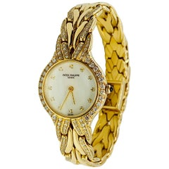 Patek Philippe Diamond and 18 Karat Yellow Gold La Flamme Ladies Watch