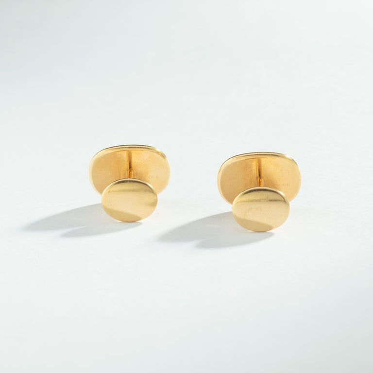 Patek Philippe Ellipse Yellow Gold 18k Cufflinks 1970S. Largest size.   Handsome 18K yellow gold cufflinks from the Ellipse collection by Patek Philippe. These are the largest size available and feature a sharp blue sunburst face. Refined and