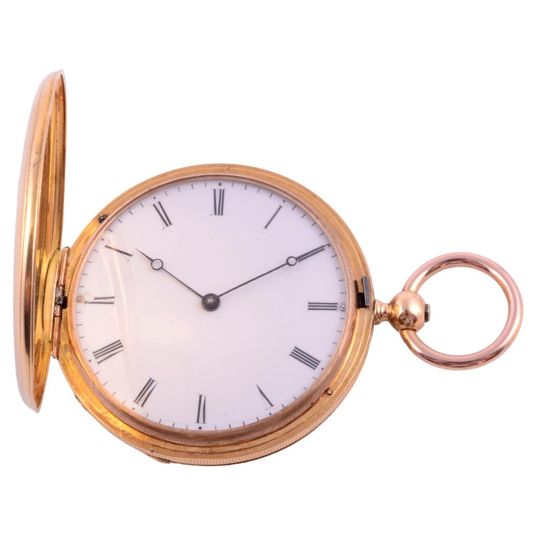 Antique Patek Philippe enameled 18K pocket watch, circa 1850. This 18 karat yellow gold key wind hunter case pocket watch made by Patek Philippe features enamel and engraving on both sides. The case is signed N5090 FY & E NY Patek Philippe 1 Geneve.