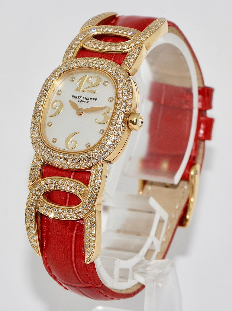 Patek Philippe Golden Ellipse Ladies Wristwatch, with MOP and Diamonds. 18K Gold.  Patek Philippe Reference: 4832  Pure luxury. Respectable Lady of Patek Philippe. 18ct yellow gold. With mother of pearl and diamond dial. Watch case also set with