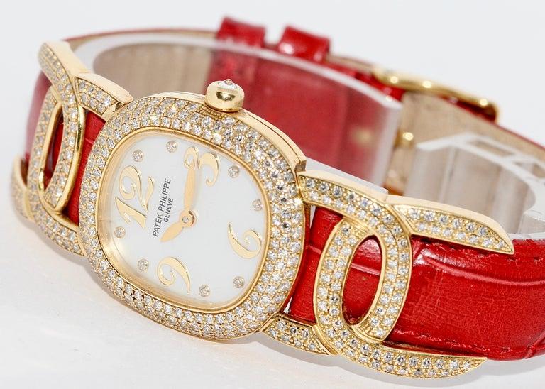 Patek Philippe Golden Ellipse Ladies Wristwatch, with MOP and Diamonds 18K Gold In Fair Condition For Sale In Berlin, DE