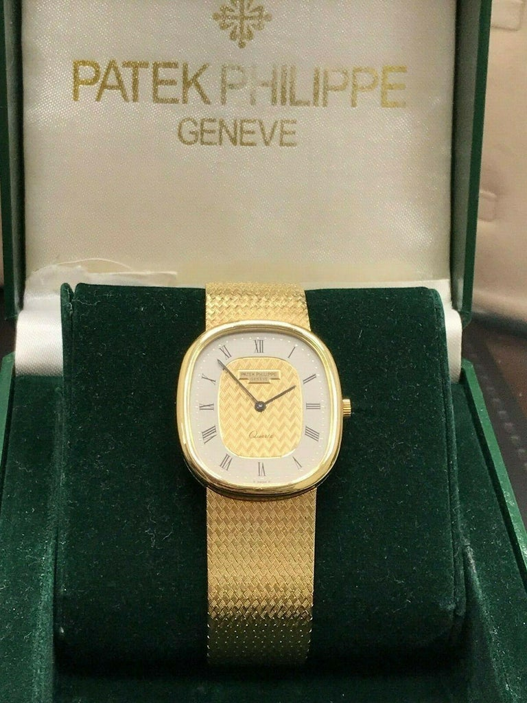Style Number: Ref 3838 Year: 1980's Model: Ellipse  Case Material: 18K Yellow Gold Band: 18K Yellow Gold Bezel: 18K Yellow Gold Dial: Champagne  Face: Sapphire Crystal Case Size: 32mm x 25mm  Includes:  -Patek Box  -Certified Appraisal  -1 Year