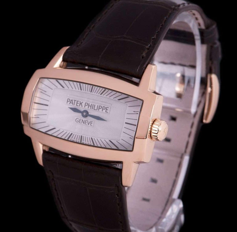 An 18k Rose Gold Gondolo Gemma Ladies Wristwatch, white mother of pearl dial with hour markers, blued steel hands, a fixed 18k rose gold bezel, an original brown leather strap with an original 18k rose gold pin buckle, faceted sapphire glass, quartz