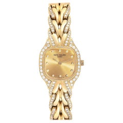 Patek Philippe La Flamme 18 Karat Yellow Gold Diamond Ladies Watch 4715