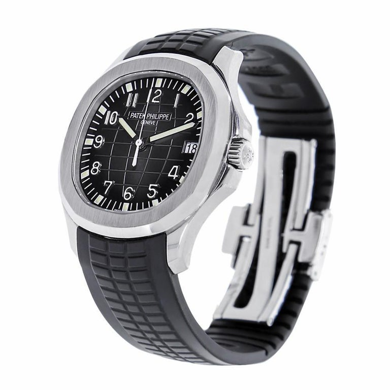 Patek Philippe Aquanaut Reference #:5167A-001. 40mm stainless steel case, sapphire crystal back, embossed black dial, self winding caliber 324 S C movement with date, approximately 45 hour of power reserve, Tropical composite black strap with