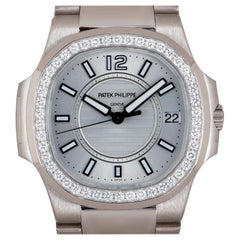 Patek Philippe Nautilus 18 Karat Gold Silver Dial Diamond Bezel B&P 7010/1G-001