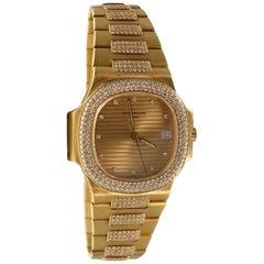 Patek Philippe Nautilus 3800/5 in 18 Karat Yellow Gold with Diamond Bezel Watch