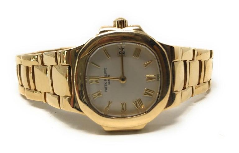 Patek Philippe Nautilus 4700/51J-001  18 Karat Yellow Gold Women's Watch Reference number # 4700/51J-001 Model name: Nautilus  Case diameter: 27mm Case diameter with crown: 29mm Case thickness: 7mm Case material: 18 karat yellow gold Movement: