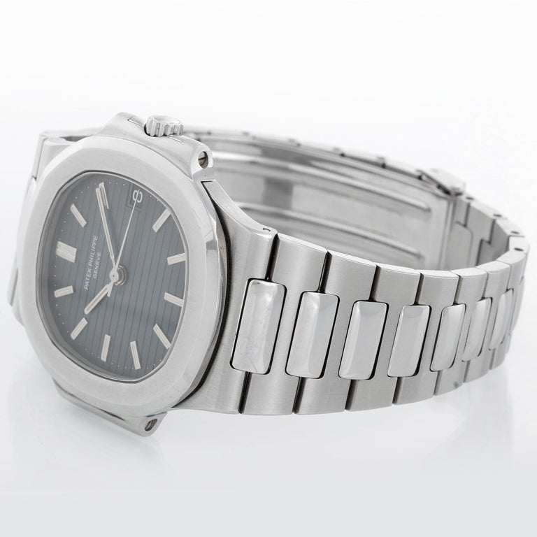 Patek Philippe Nautilus Men's Stainless Steel 38mm Watch 3800 - Automatic winding. Stainless steel case (38mm x 43mm). Gray-blue dial with stick markers; date at 3 o'clock. Stainless steel Nautilus bracelet. From original owners family. It has only