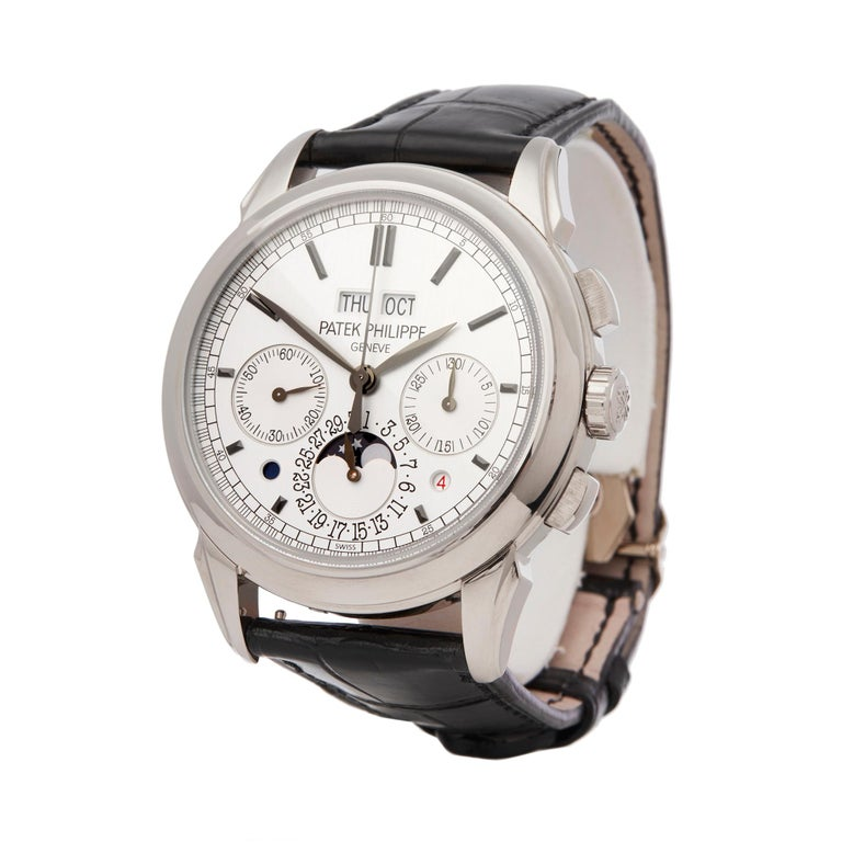 Reference: COM2087 Manufacturer: Patek Philippe Model: Perpetual Calendar Model Reference: 5270G-001 Age: 24th November 2011 Gender: Men's Box and Papers: Box, Manuals and Guarantee Dial: Silver Baton Glass: Sapphire Crystal Mechanical