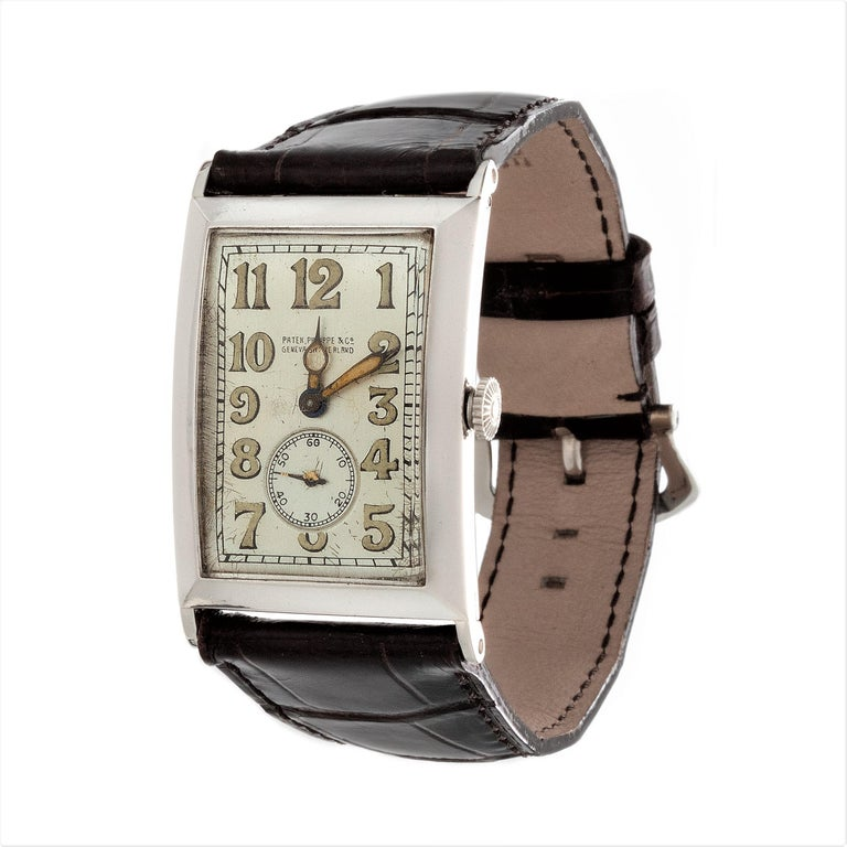 Women's or Men's Patek Philippe Platinum Curved Hinged Case Art Deco Watch, circa 1927 For Sale