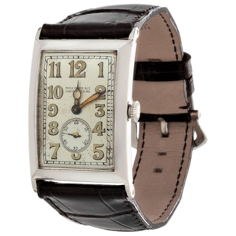 Patek Philippe Platinum Curved Hinged Case Art Deco Watch, circa 1927 For Sale