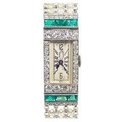 Patek Philippe Platinum Diamond Emerald and Pearl Bracelet 1920s Wristwatch