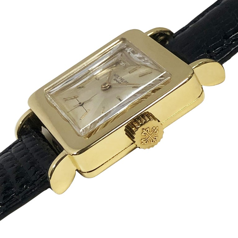 Circa 1950 Patek Philippe Wrist Watch, 36 M.M. from Lug end to end  X  26 M.M. 18K Yellow Gold 2 Piece case, 18 Jewel Mechanical, manual wind nickle lever movement, Silver Satin dial with Sub seconds chapter and raised Gold markers, original Patek