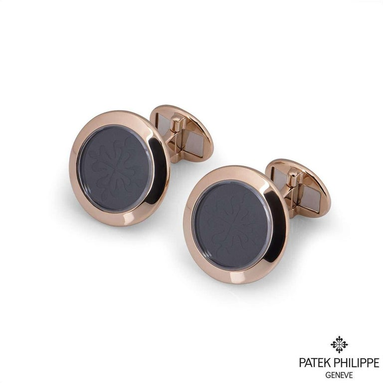 A sublime pair of 18k rose gold Patek Philippe cufflinks from the Calatrava collection. Each cufflink is set to the centre with onyx, engraved with the iconic Calatrava cross emblem. The feature motif measures 1.9cm in diameter and the body of the