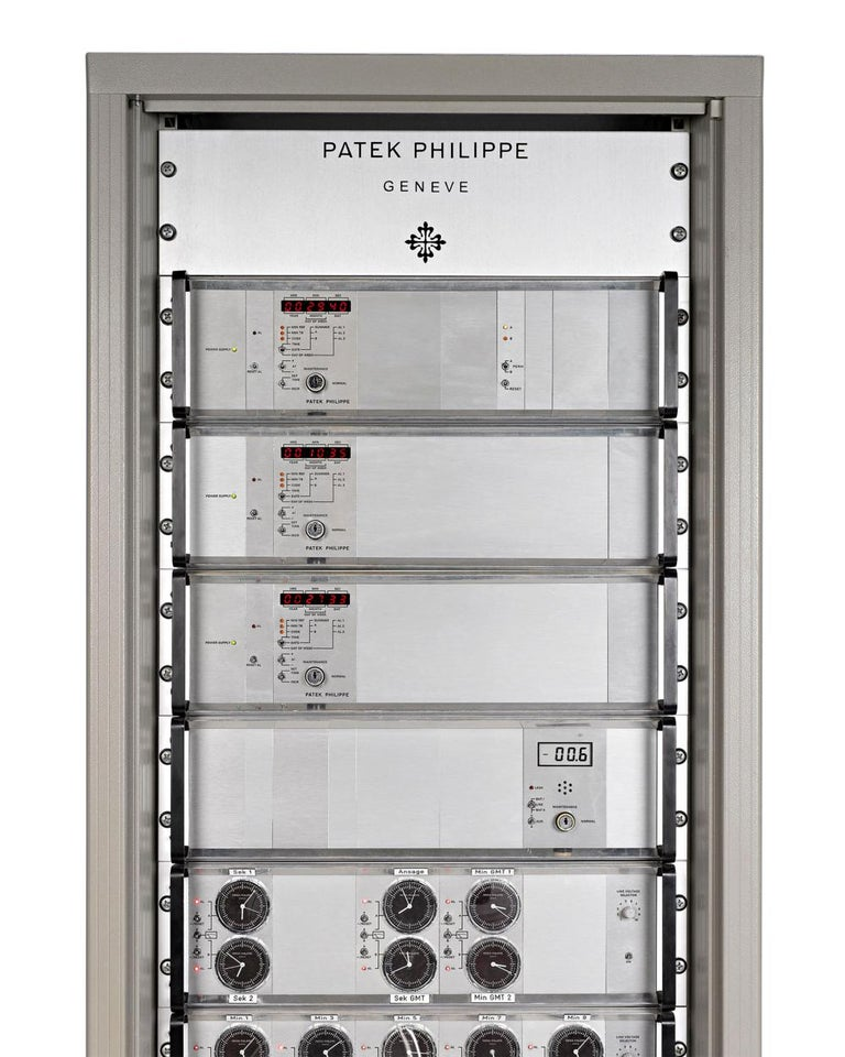 This rare nine-module time tower by Patek Philippe of Geneva represents the most state of the art master timing systems of its day. Part of the highly regarded and technologically advanced Patek Philippe Electronic Clock System, this master clock