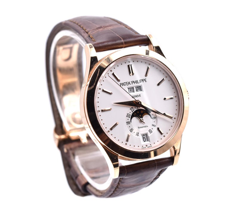 Movement: automatic, Caliber 324 S QALU 24H/303 Function: annual calendar, moon phase, month, date, day, hour, minute, second, 24-hour display Case: 33.3mm rose gold round case, sapphire crystal Dial: white stick Tiffany & Co. dial Band: Patek