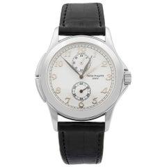 Patek Philippe Travel Time 18 Karat Gold White Dial Hand-Wind Men's Watch 5134G