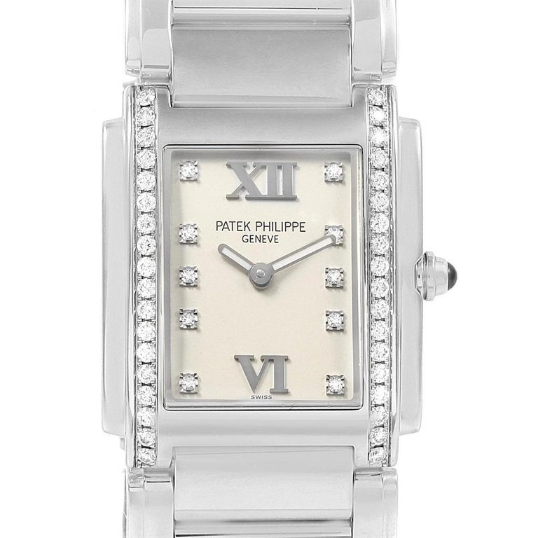 Patek Philippe Twenty-4 Diamond Ladies Quartz Watch 4910/10A-010. Quartz movement. Stainless steel case 25.0 x 30.0 mm. Onyx set crown. Original Patek factory 38 diamond bezel. Scratch resistant sapphire crystal. Silver dial with original Patek