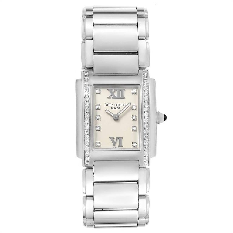 Patek Philippe Twenty-4 Diamond Ladies Quartz Watch 4910/10A-010. Quartz movement. Stainless steel case 25.0 x 30.0 mm. Onyx set crown. Original Patek factory 38 diamond bezel. Scratch resistant sapphire crystal. Silver dial with original Patek
