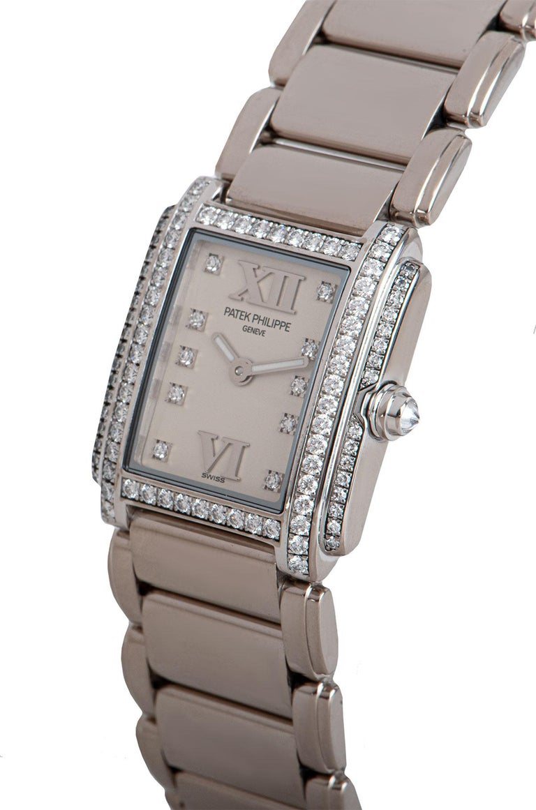 A 22 mm 18k White Gold Twenty-4 Ladies Wristwatch, timeless white dial set with 10 applied round brilliant cut diamond hour markers, applied roman numerals VI and XII, a fixed 18k white gold bezel set with 54 round brilliant cut diamonds, an 18k