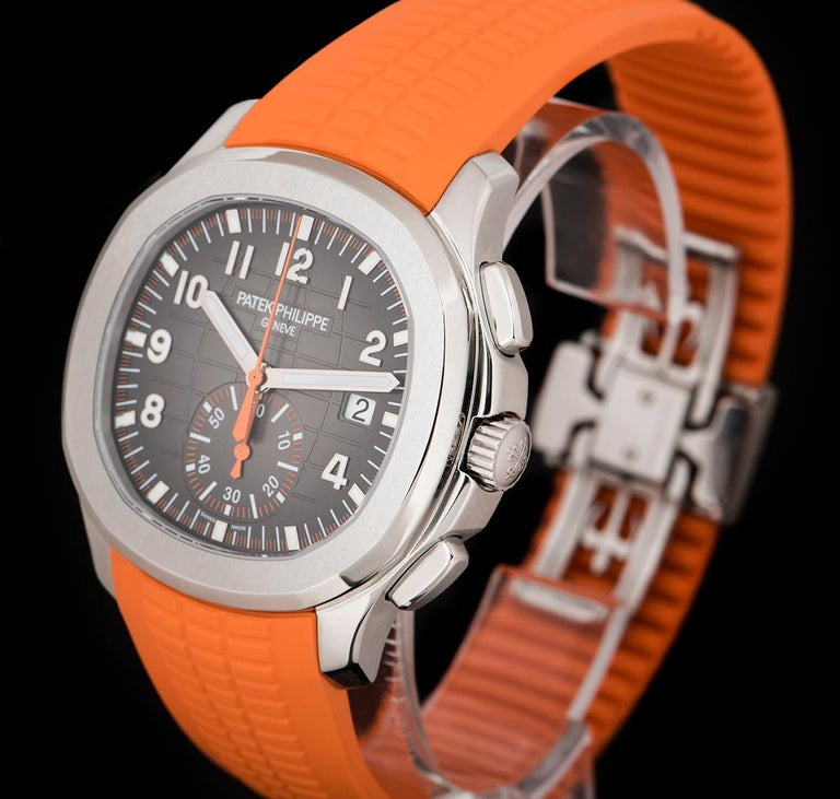 An Unworn Stainless Steel Aquanaut Gents Wristwatch, black embossed dial with applied arabic numbers, date at 3 0'clock, 60 minute recorder at 6 0'clock, orange chronograph hand, a fixed stainless steel bezel, an original orange