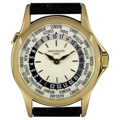 Patek Philippe World Time Yellow Gold Silver Dial 5110J-001