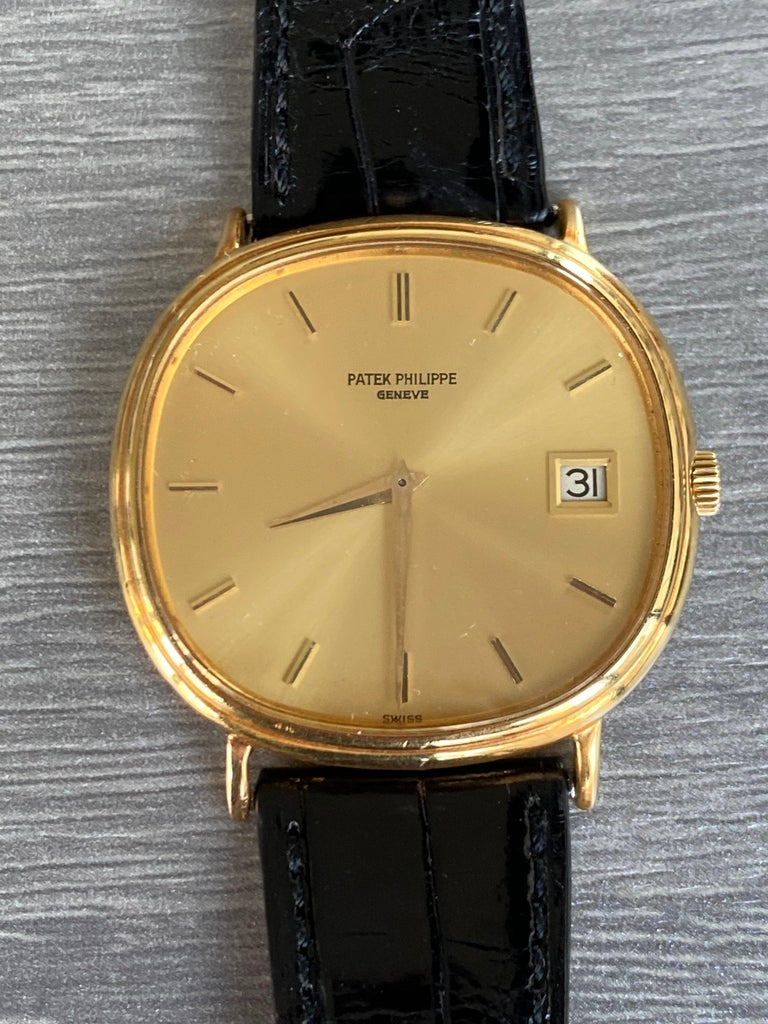Preowned, excellent condition Patek Philippe Automatic Ellipse reference 3839 18k Yellow Gold gents wristwatch.Circa 1980's. Gold dial, baton hour markers, date display at 3 o'clock, an 18k Yellow Gold 36mm case, bezel, winder and classic pin buckle