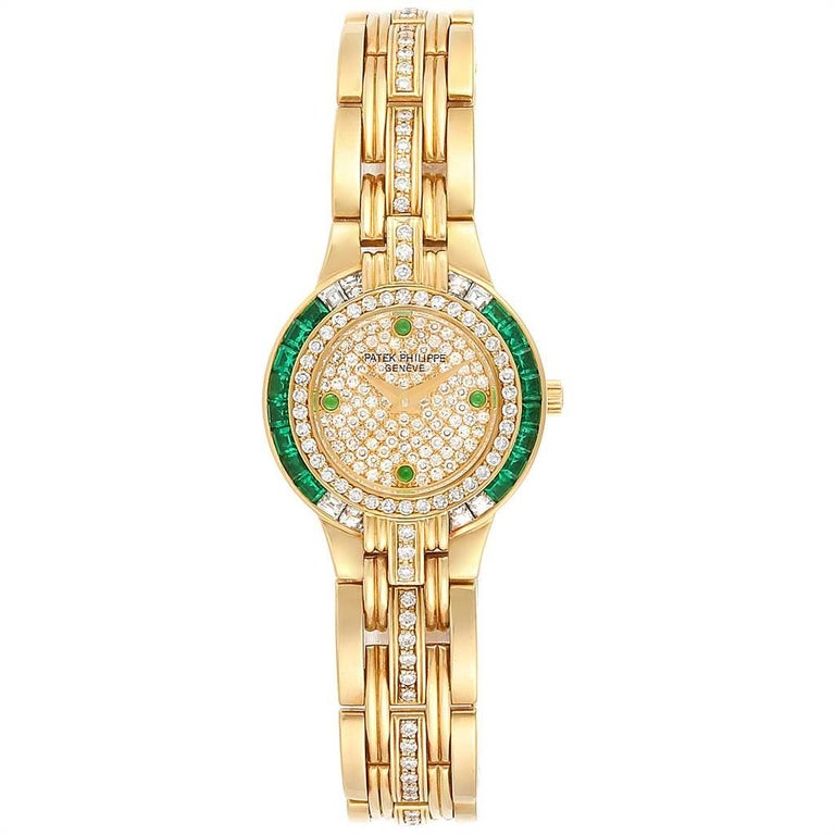 Patek Philippe Yellow Gold Diamond Emerald Ladies Watch 4786. Quartz movement. 18k yellow gold round case 23 mm in diameter. Original Patek 18K yellow gold diamond and enerald bezel. Scratch resistant sapphire crystal. Original Patek pave-set