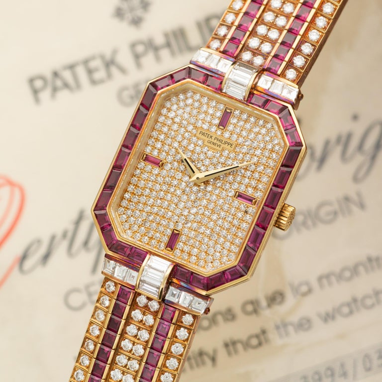 An 18k Yellow Gold Patek Philippe Watch with Original Diamonds and Rubies. Ref. 3994/033. 27mm Case Diameter. Manual Winding Movement. Accompanied by its Original Box and Papers.
